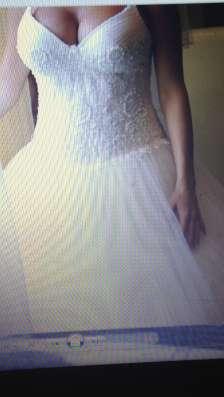 Свадебное платье, вышитое жемчугом. Очень красивое